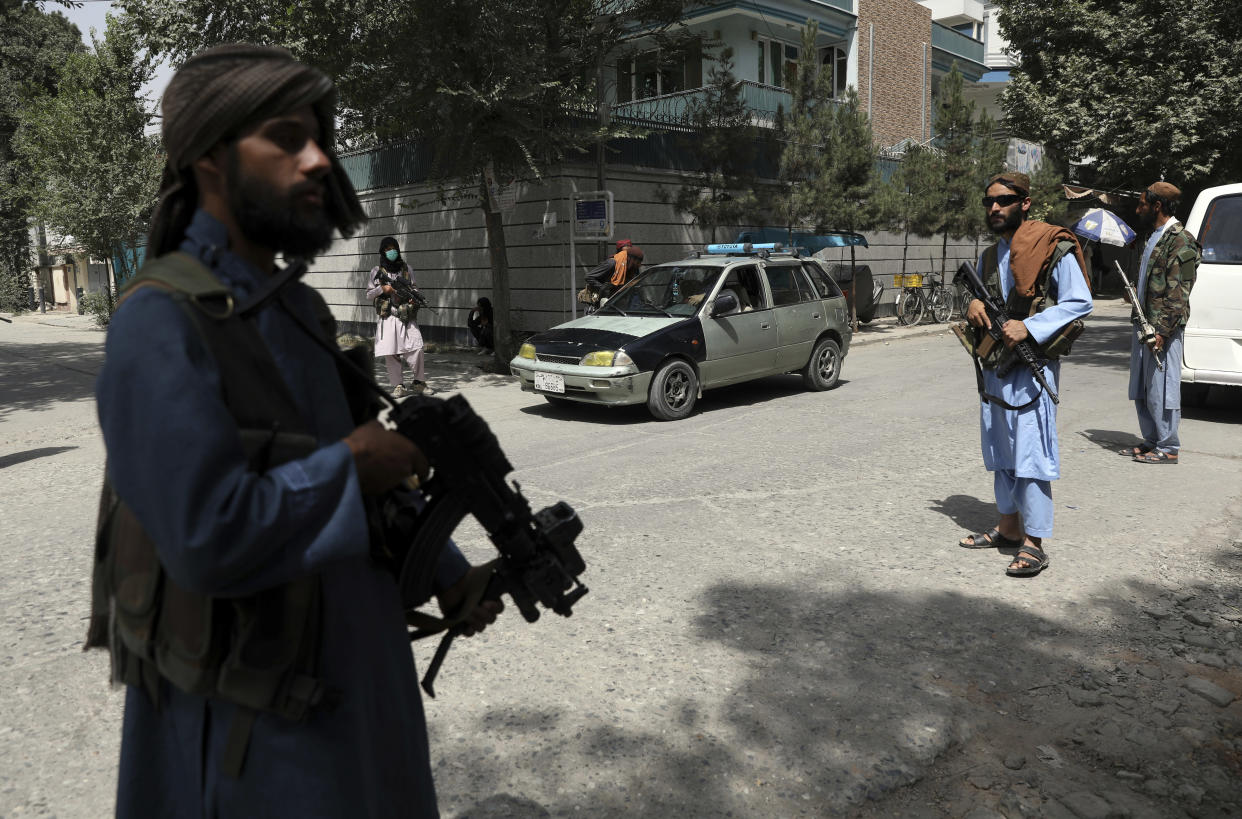 Taliban fighters stand guard at a checkpoint in the Wazir Akbar Khan neighborhood in the city of Kabul, Afghanistan, Wednesday, Aug. 18, 2021. The Taliban declared an