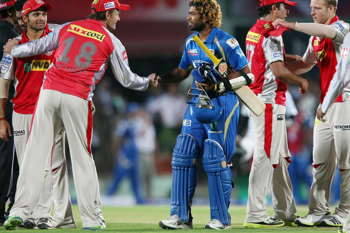 Lasith Malinga congratulates Adam Gilchrist during match 69 of the Pepsi Indian Premier League between The Kings XI Punjab and the Mumbai Indians held at the HPCA Stadium in Dharamsala, Himachal Pradesh, India on the on the 18th May 2013. (BCCI)