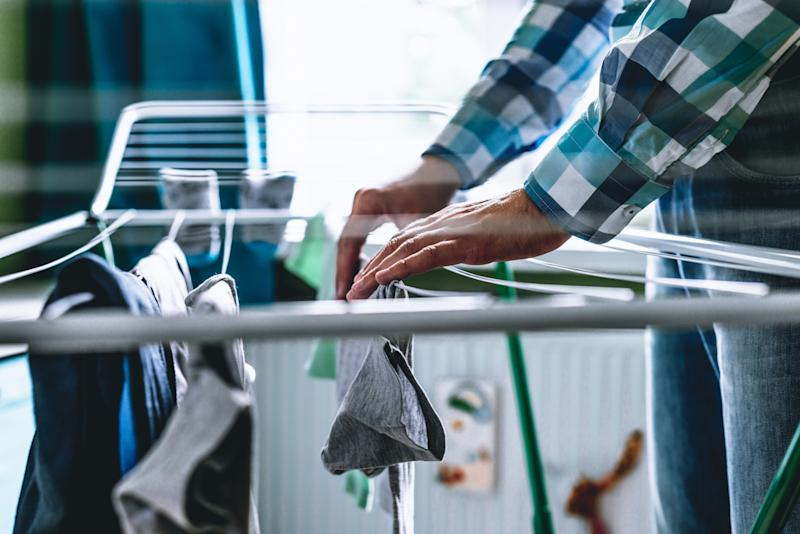 This standard clothes-drying rack is a good solution for big spaces — but what if your apartment is too small to sacrifice the floor space it requires? (Photo: Sebastian Gorczowski via Getty Images)