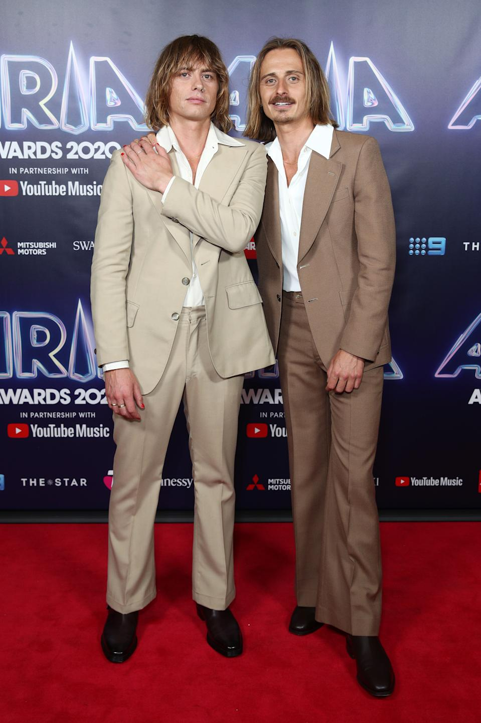 Louis Leimbach and Oliver Leimbach of Lime Cordiale wear brown seventies suits on the red carpet at the 2020 ARIA Awards at The Star on November 24, 2020 in Sydney, Australia.