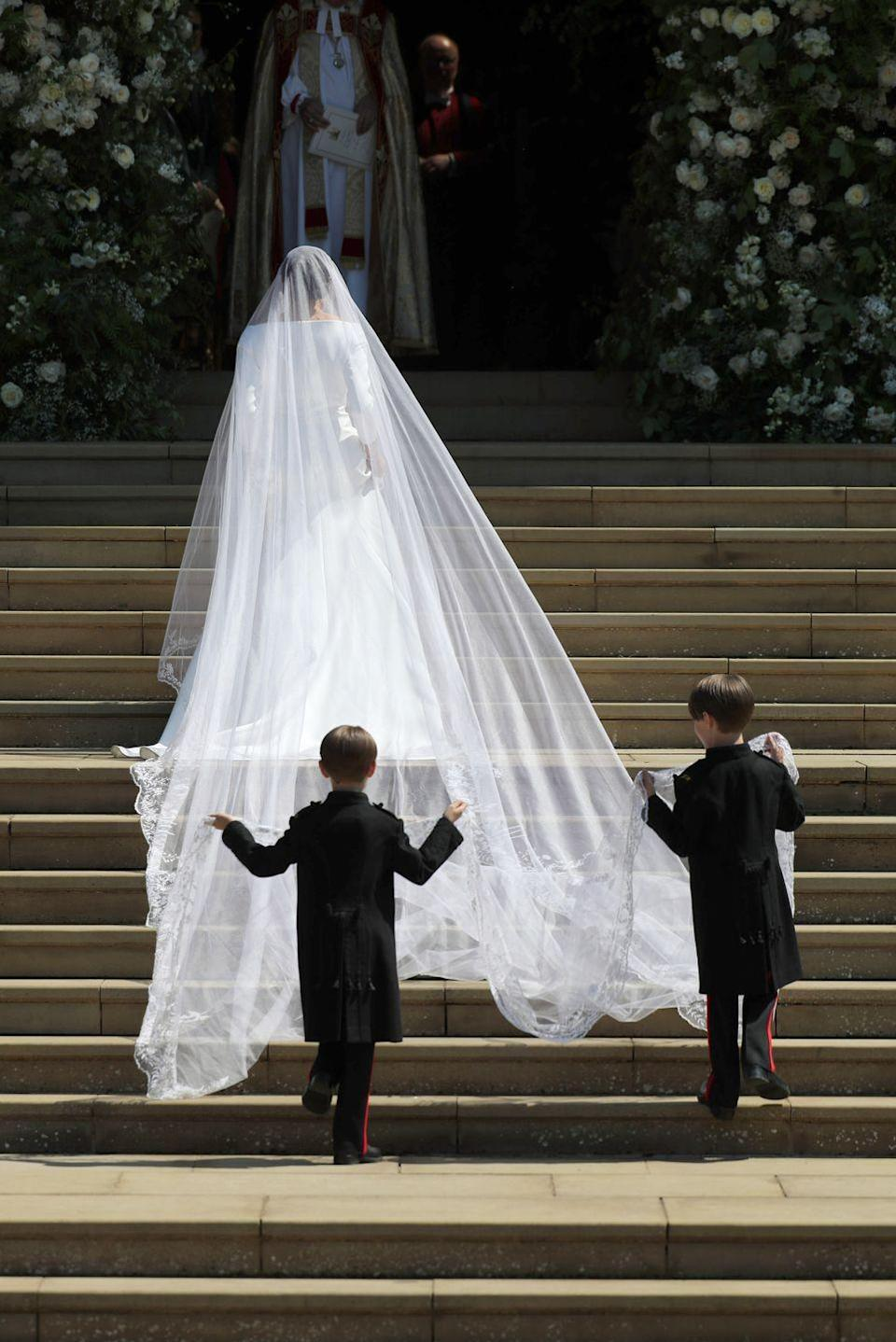 """<p>Much longer than her sister-in-law's veil, Meghan surprised her groom and <a href=""""https://www.harpersbazaar.com/celebrity/latest/a23376285/meghan-markle-wedding-veil-commonwealth-flowers-prince-harry-surprise/"""" rel=""""nofollow noopener"""" target=""""_blank"""" data-ylk=""""slk:paid homage"""" class=""""link rapid-noclick-resp"""">paid homage</a> to her new home by featuring flowers from all 53 of the countries in the British Commonwealth on it.</p>"""