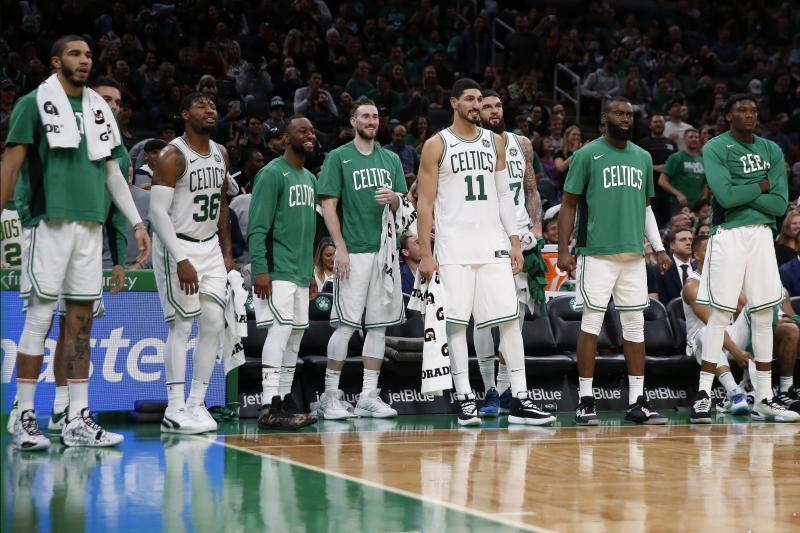 The Boston Celtics watch from the bench during the second half of a preseason NBA basketball game against the Charlotte Hornets in Boston, Sunday, Oct. 6, 2019. (AP Photo/Michael Dwyer)
