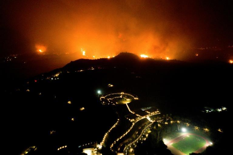 A wildfire approaches the Olympic Academy in ancient Olympia in western Greece on August 4, 2021