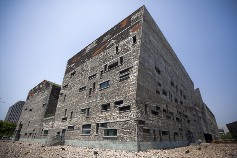 This April 22, 2012 photo shows Ningbo History Museum, one of Chinese architect Wang Shu's most famous works, in Ningbo, in eastern China's Zhejiang province. When Wang accepts his field's richest prize in a ceremony Friday, May 25, 2012, at the seat of China's legislature, a symbolic second winner will be waiting in the background - Hyatt Hotels. (AP Photo) CHINA OUT