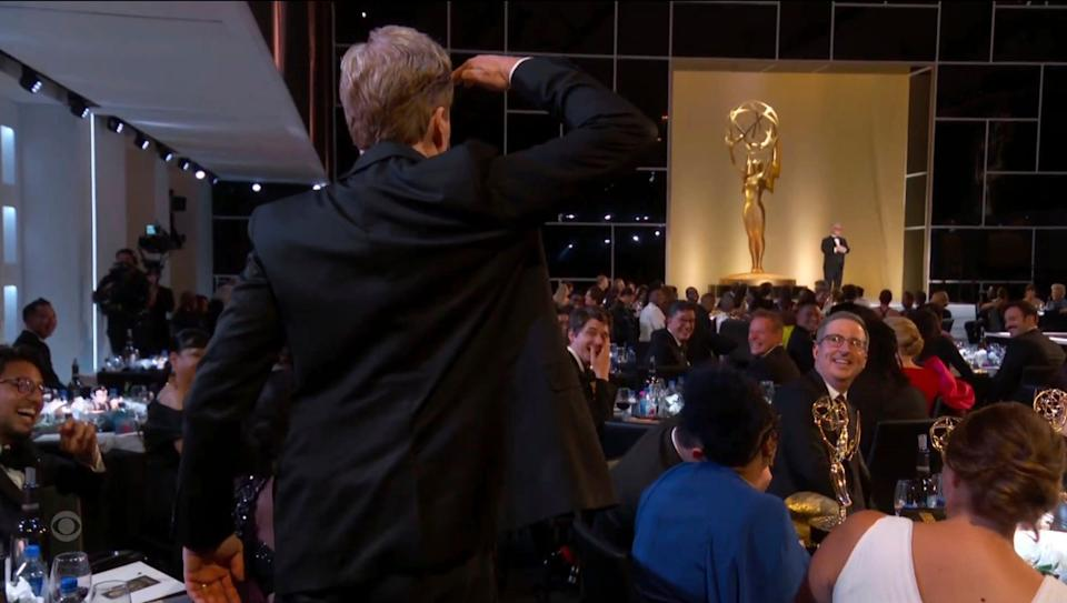 Conan O'Brien salutes Television Academy Chairman and CEO, Frank Scherma during the Primetime Emmy Awards.