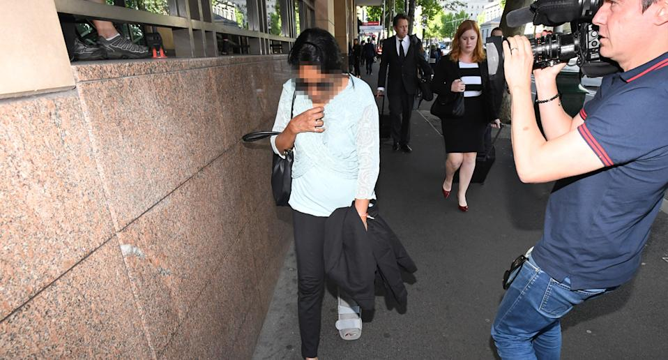 A woman leaves the Melbourne Magistrates Court in Melbourne.