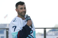 Jordan Eberle, a forward from the New York Islanders, speaks after being introduced as a new player for the Seattle Kraken, Wednesday, July 21, 2021, during the Kraken's NHL hockey expansion draft event in Seattle. (AP Photo/Ted S. Warren)