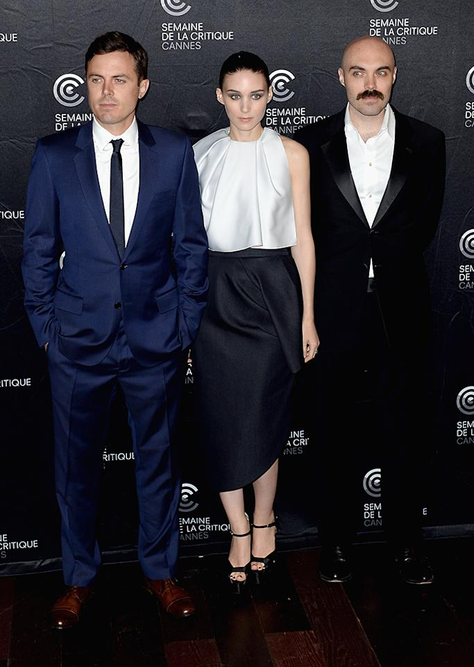 CANNES, FRANCE - MAY 18:  (L-R) Actors Casey Affleck, Rooney Mara and writer/director David Lowery poses during the 'Ain't Them Bodies Saints' Photocall during The 66th Annual Cannes Film Festival at the Palais des Festivals on May 18, 2013 in Cannes, France.  (Photo by Samir Hussein/Getty Images)