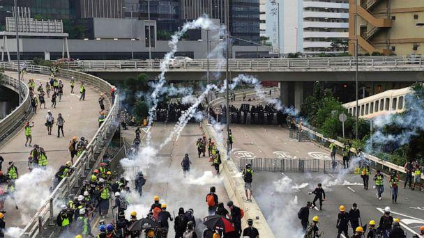 PHOTO: Clouds of smoke rise from tear gas canisters as police and demonstrators clash during a protest in Hong Kong, Saturday, Aug. 24, 2019. (Vincent Yu/AP)
