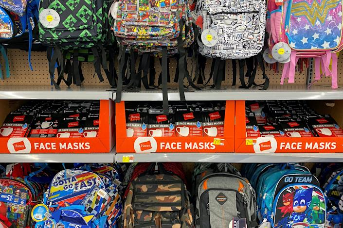 Face masks and backpacks for sale at a Walmart store in Encinitas, California.