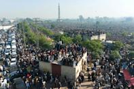 Crowds of mourners gather for funeral prayers for hardline Pakistani cleric Khadim Hussain Rizvi in Lahore