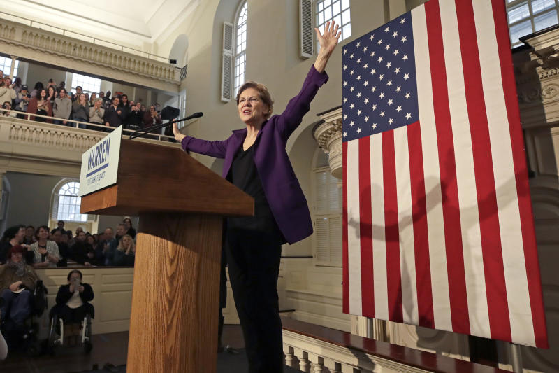 Democratic presidential candidate Sen. Elizabeth Warren, D-Mass., acknowledges the crowd during a campaign event at the Old South Meeting House, Friday, Dec. 31, 2019, in Boston. (AP Photo/Elise Amendola)