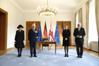 Prince Charles and his wife Camilla are standing next to Federal President Frank-Walter Steinmeier, right, and his wife Elke Büdenbender, 2nd from right, before a conversation in Bellevue Palace in Berlin, Germany, Sunday, Nov.14, 2020. The Prince of Wales and the Duchess of Cornwall are in Berlin on the occasion of the central commemoration of the Volkstrauertag. This year's national day of mourning in memory of the victims of National Socialism and the dead of both world wars is dedicated to German-British friendship. Photo: (Kay Nietfeld/dpa via AP)