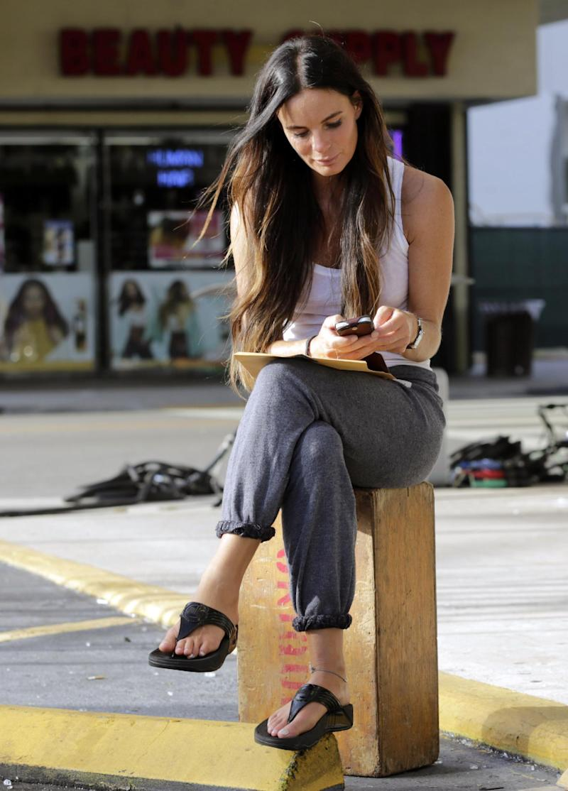 "In this July 24, 2013, photo, Gabrielle Anwar relaxes between rehearsals for an episode of ""Burn Notice"" in Miami. The cable spy drama is coming to an end after seven seasons with a big finale Thursday, Sept. 12, 2013. (AP Photo/Alan Diaz)"
