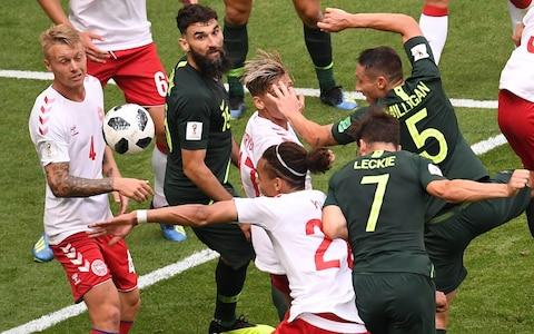 Denmark's defender Simon Kjaer (L) and Australia's midfielder Mile Jedinak (2L) eye the ball during the Russia 2018 World Cup Group C football match between Denmark and Australia at the Samara Arena in Samara on June 21, 2018 - Credit: AFP