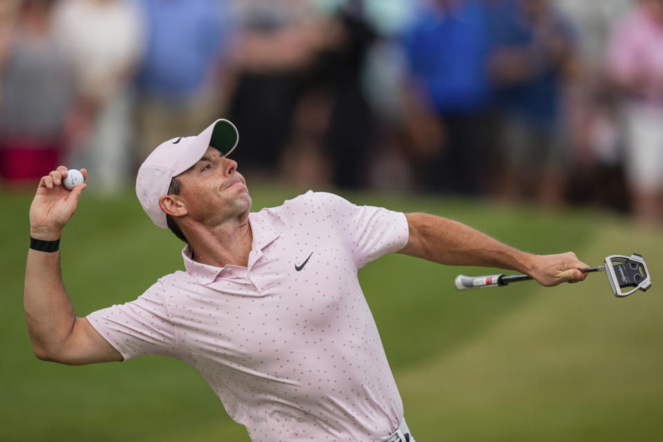Rory McIlroy throws his ball to the crowd after winning on the 18th hole during the fourth round of the Wells Fargo Championship golf tournament at Quail Hollow on Sunday, May 9, 2021, in Charlotte, N.C. (AP Photo/Jacob Kupferman)