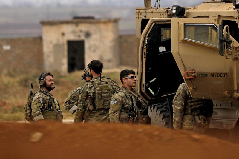 Members of the Syrian Democratic Forces (SDF) and US soldiers patrol the Kurdish-held town of al-Darbasiyah in northeastern Syria bordering Turkey on November 4, 2018 (AFP Photo/Delil SOULEIMAN)