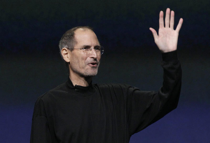 Apple Inc. Chairman and CEO Steve Jobs waves to his audience at an Apple event at the Yerba Buena Center for the Arts Theater in San Francisco, Wednesday, March 2, 2011. (AP Photo/Jeff Chiu)