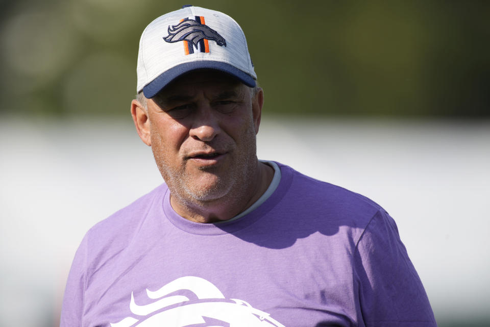 Denver Broncos head coach Vic Fangio looks on as players take part in drills during an NFL football training camp at the team's headquarters Wednesday, Aug. 18, 2021, in Englewood, Colo. (AP Photo/David Zalubowski)