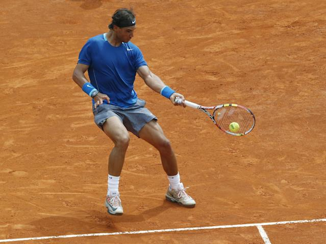 Rafael Nadal of Spain returns the ball to David Ferrer of Spain during their quarterfinals match of the Monte Carlo Tennis Masters tournament in Monaco, Friday, April 18, 2014. Ferrer won 7-6 6-4. (AP Photo/Michel Euler)