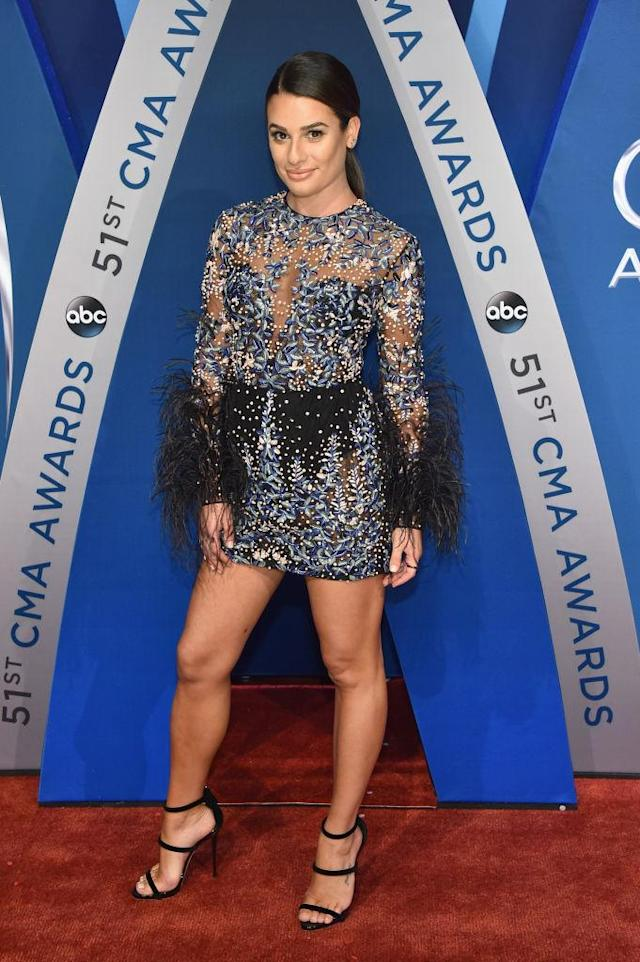 <p>The actress came prepared for the Tennessee heat with an embellished minidress and strappy shoes. (Photo: Getty Images) </p>