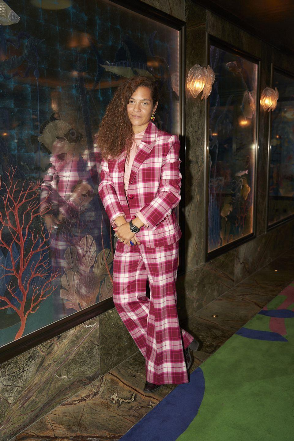 <p><strong>28 September</strong><br></p><p>Photographer Lily Bertrand-Webb wore a colourful checked suit to attend the Omega lunch. </p>