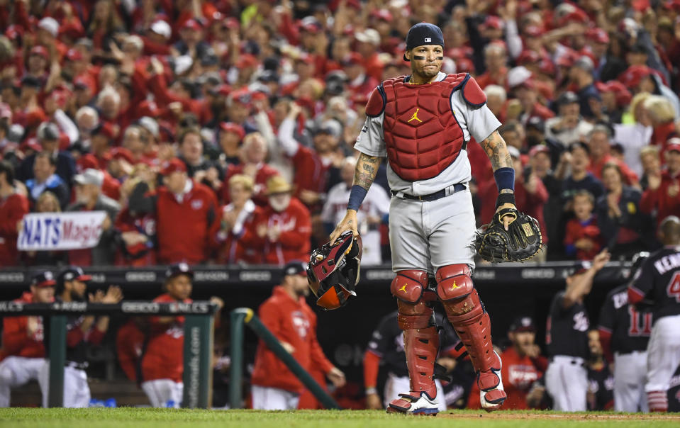 WASHINGTON, DC - OCTOBER 15: St. Louis Cardinals catcher Yadier Molina (4) looks on in a rough first inning of Game Four of the NLCS between the Washington Nationals and the St. Louis Cardinals at Nationals Park. (Photo by Jonathan Newton /The Washington Post via Getty Images)