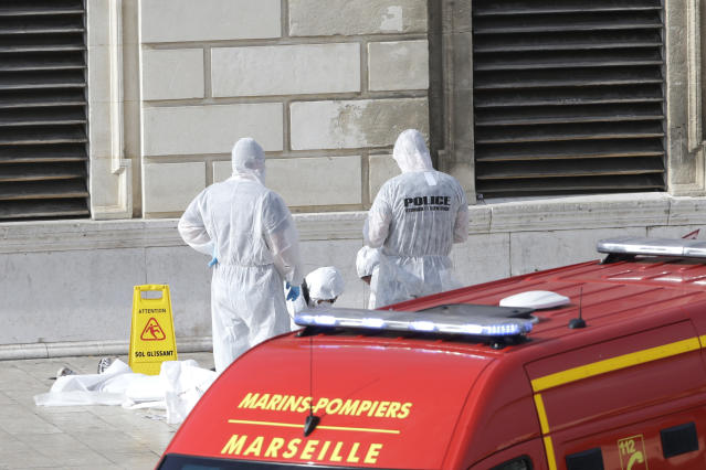 <p>Investigative police officers work at a body outside Marseille 's main train station, Oct. 1, 2017 in Marseille, southern France. A man with a knife attacked people at the main train station in the southeastern French city of Marseille on Sunday, killing two women before soldiers fatally shot the assailant, officials said. (AP Photo/Claude Paris) </p>