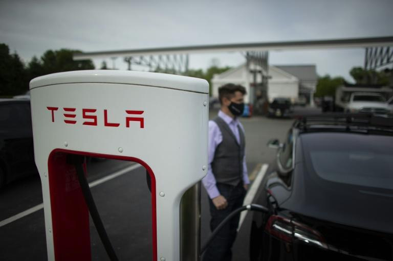 A Tesla vehicle at a super charging station in Parsippany, New Jersey on May 06, 2021: studies show that many public charging stations are under-used, as most EV owners charge their cars at home or work