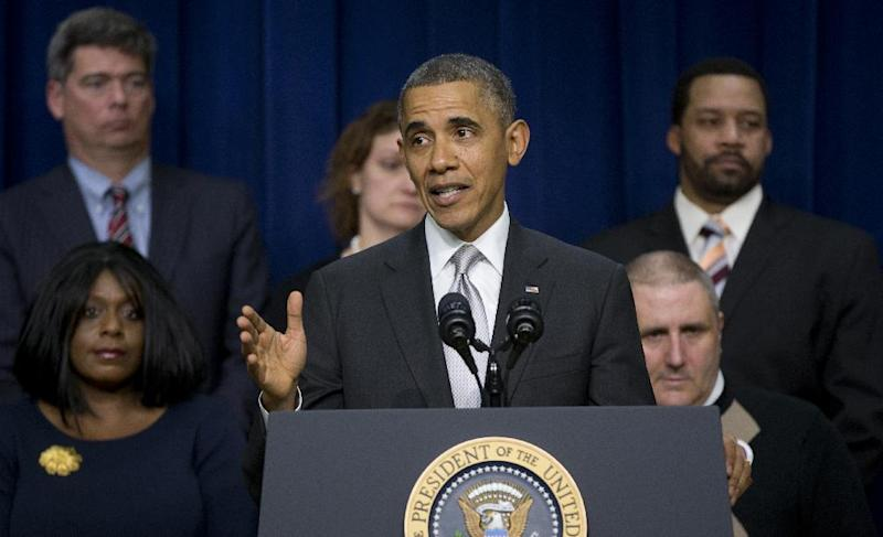 "President Barack Obama gestures as he speaks about the new health care law, Tuesday, Dec. 3, 2013, in the South Court Auditorium in the Eisenhower Executive Office Building on the White House complex in Washington. The president said his signature health care law ""is working and will work into the future."" Obama said the benefits of the law have ""gotten lost"" in recent months as attention focused on the widespread problems that crippled the website where people can sign up for health insurance. On stage with the president are Americans the White House says have gained as a result of the Affordable Care Act. (AP Photo/Carolyn Kaster)"