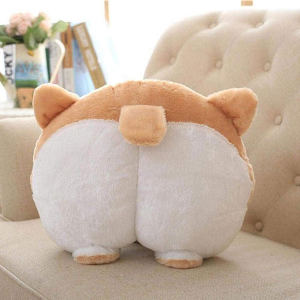 """<p>Perfect for the pooch people who can't get over how adorable Corgi butts are. </p> <p><strong>Buy it!</strong> Waty Corgi Dog Plush Pillow, $15.99; <a href=""""https://www.amazon.com/dp/B07KXTK1QC?tag=january2021rover-20&linkCode=ogi&th=1&psc=1"""" rel=""""nofollow noopener"""" target=""""_blank"""" data-ylk=""""slk:Amazon.com"""" class=""""link rapid-noclick-resp"""">Amazon.com</a></p>"""