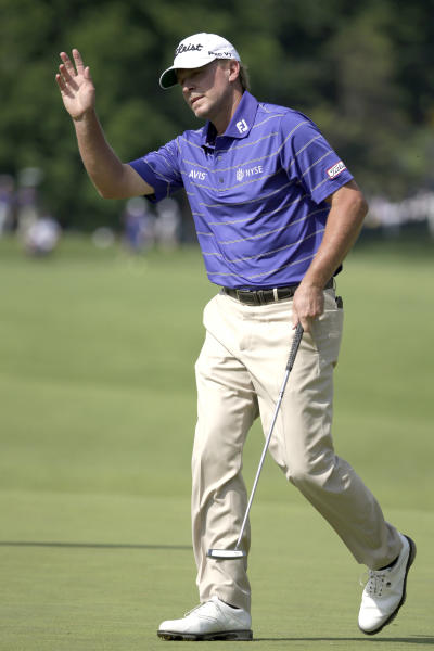 Steve Stricker reacts after a birdie putt on the fifth hole during the third round of the U.S. Open golf tournament at Merion Golf Club, Saturday, June 15, 2013, in Ardmore, Pa. (AP Photo/Gene J. Puskar)
