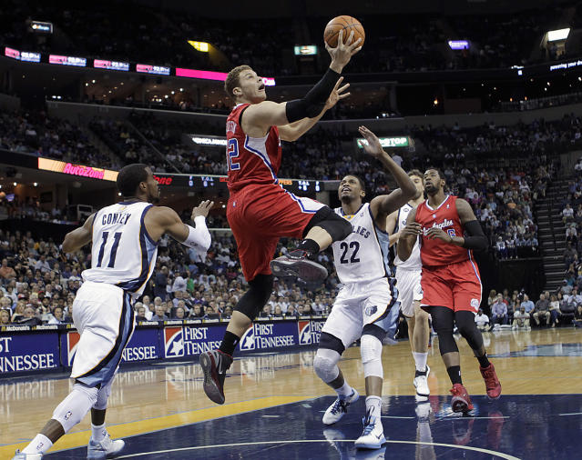 Los Angeles Clippers forward Blake Griffin (32) goes to the basket against Memphis Grizzlies guard Mike Conley (11) and forward Rudy Gay (22) in the first half of an NBA basketball game Monday, April 9, 2012, in Memphis, Tenn. (AP Photo/Lance Murphey)