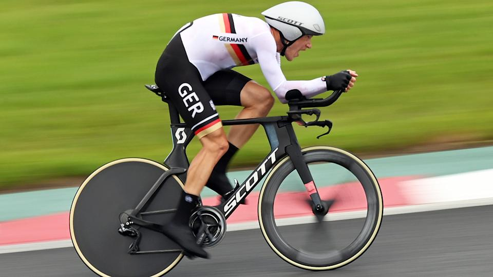 A high-ranking German cycling official was caught on camera making racist comments about competitors during the men's time trial in Tokyo. (Photo by Sebastian Gollnow/picture alliance via Getty Images)