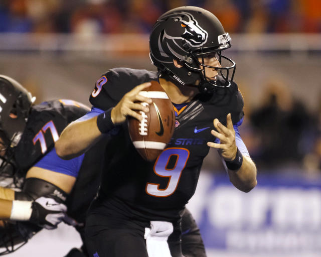 Boise State quarterback Grant Hedrick (9) looks for a receiver against Nevada during the first half of an NCAA college football game in Boise, Idaho, Saturday, Oct. 19, 2013. (AP Photo/Otto Kitsinger)