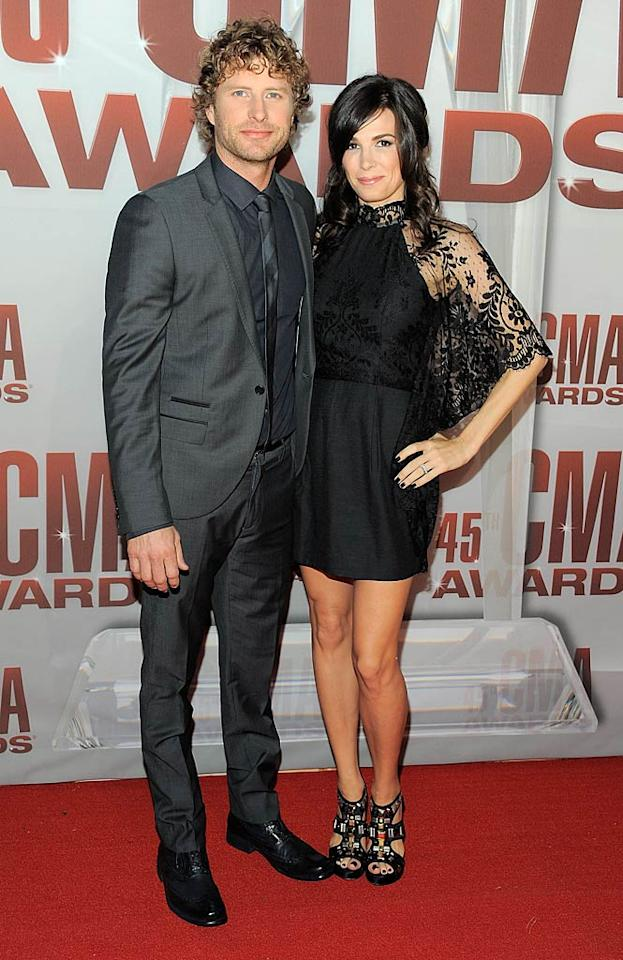 Crooner Dierks Bentley looked dapper, although he could have used a steam cleaning. Meanwhile, wife Cassidy Black could have used a whole new outfit! (11/9/2011)