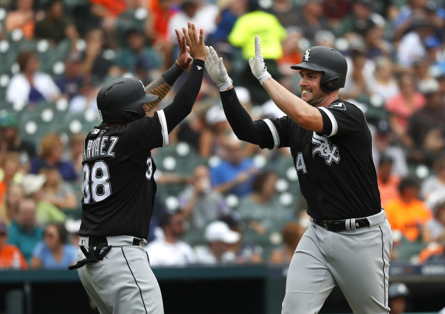 Chicago White Sox's Matt Davidson, right, celebrates hitting a two-run home run with Omar Narvaez (38) in the fourth inning of a baseball game against the Detroit Tigers in Detroit, Wednesday, Aug. 15, 2018. (AP Photo/Paul Sancya)