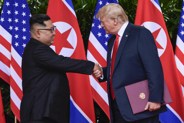 <p>FILE – In this June 12, 2018, file photo, North Korea leader Kim Jong Un, left, and U.S. President Donald Trump shake hands at the conclusion of their meetings at the Capella resort on Sentosa Island in Singapore. The series of photos on the front page of the ruling workers' party newspaper showed something North Koreans never would have imagined just months ago, their leader Kim Jong Un warmly shaking hands with President Donald Trump. (AP Photo/Susan Walsh, Pool, Fie) </p>