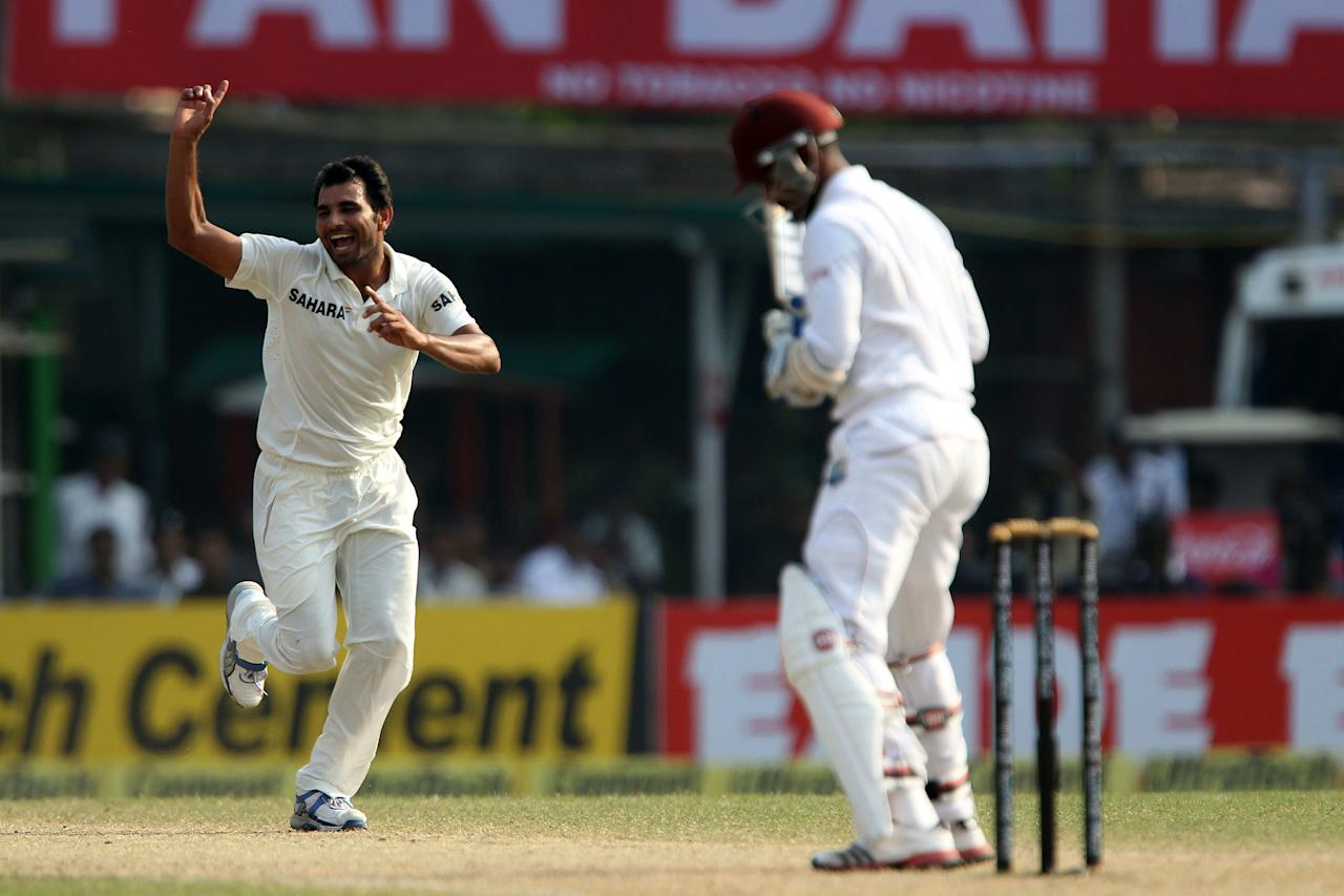 Mohammed Shami celebrates the wicket of Denesh Ramdin of West Indies  during day three of the first Star Sports test match between India and The West Indies held at The Eden Gardens Stadium in Kolkata, India on the 8th November 2013  Photo by: Ron Gaunt - BCCI - SPORTZPICS