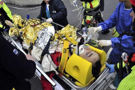 FILE PHOTO - Rescue workers carry Formula One driver Robert Kubica of Poland following an accident in a rally car during a minor rally near Genoa February 6, 2011. REUTERS/Stringer