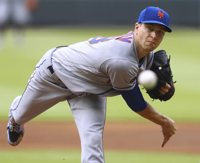New York Mets pitcher Jacob deGrom throws against the Atlanta Braves during the first inning of a baseball game Wednesday, June 13, 2018, in Atlanta. (Curtis Compton/Atlanta Journal-Constitution via AP)