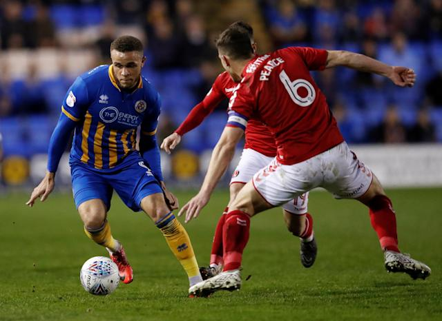 "Soccer Football - League One - Shrewsbury Town vs Charlton Athletic - Montgomery Waters Meadow, Shrewsbury, Britain - April 17, 2018 Shrewsbury Town's Carlton Morris in action with Charlton's Jason Pearce Action Images/Andrew Boyers EDITORIAL USE ONLY. No use with unauthorized audio, video, data, fixture lists, club/league logos or ""live"" services. Online in-match use limited to 75 images, no video emulation. No use in betting, games or single club/league/player publications. Please contact your account representative for further details."