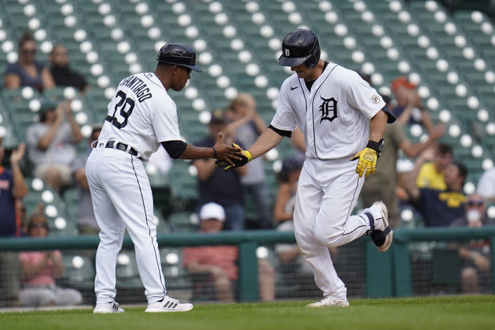 Detroit Tigers' Dustin Garneau hits a solo home run against the Milwaukee Brewers in the seventh inning of a baseball game in Detroit, Wednesday, Sept. 15, 2021. (AP Photo/Paul Sancya)