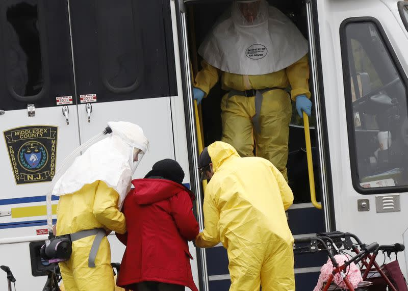 FILE PHOTO: Medical officials aid a residents from St. Joseph's nursing home to board a bus, after a number of residents tested positive for coronavirus disease (COVID-19) in Woodbridge, New Jersey