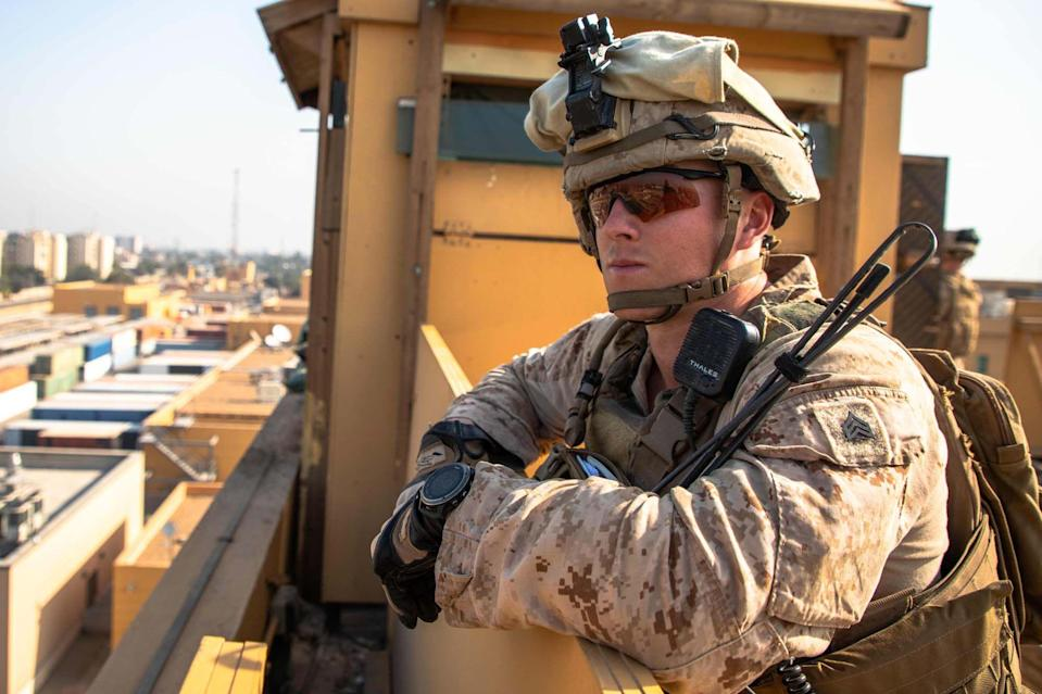 This handout image released courtesy of the US Department of Defense (DOD) shows US Marines with 2nd Battalion, 7th Marines, assigned to the Special Purpose Marine Air-Ground Task Force-Crisis Response-Central Command (SPMAGTF-CR-CC) 19.2, reinforcing the Baghdad Embassy Compound in Iraq on January