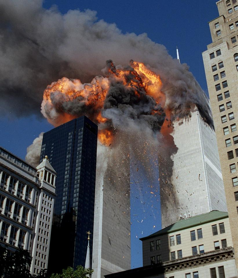 FILE - In this Sept. 11, 2001 file photo, smoke, flames and debris erupt from one of the World Trade Center towers after a plane strikes it, in New York. The first tower was already burning following a similar attack minutes earlier. Osama bin Laden, the glowering mastermind behind the Sept. 11, 2001, terror attacks that killed thousands of Americans, was slain in his luxury hideout in Pakistan early Monday, May 2, 2011 in a firefight with U.S. forces, ending a manhunt that spanned a frustrating decade.