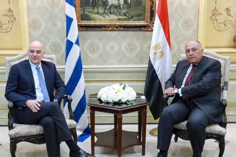 After the talks in Libya, Dendias (L) flew to Cairo, where he met his Egyptian counterpart Sameh Shoukry (AFP Photo/-)