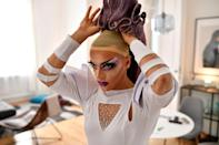 Drag queen Elona Musk prepares before a demonstration against the latest anti-LGBTQ law in Budapest