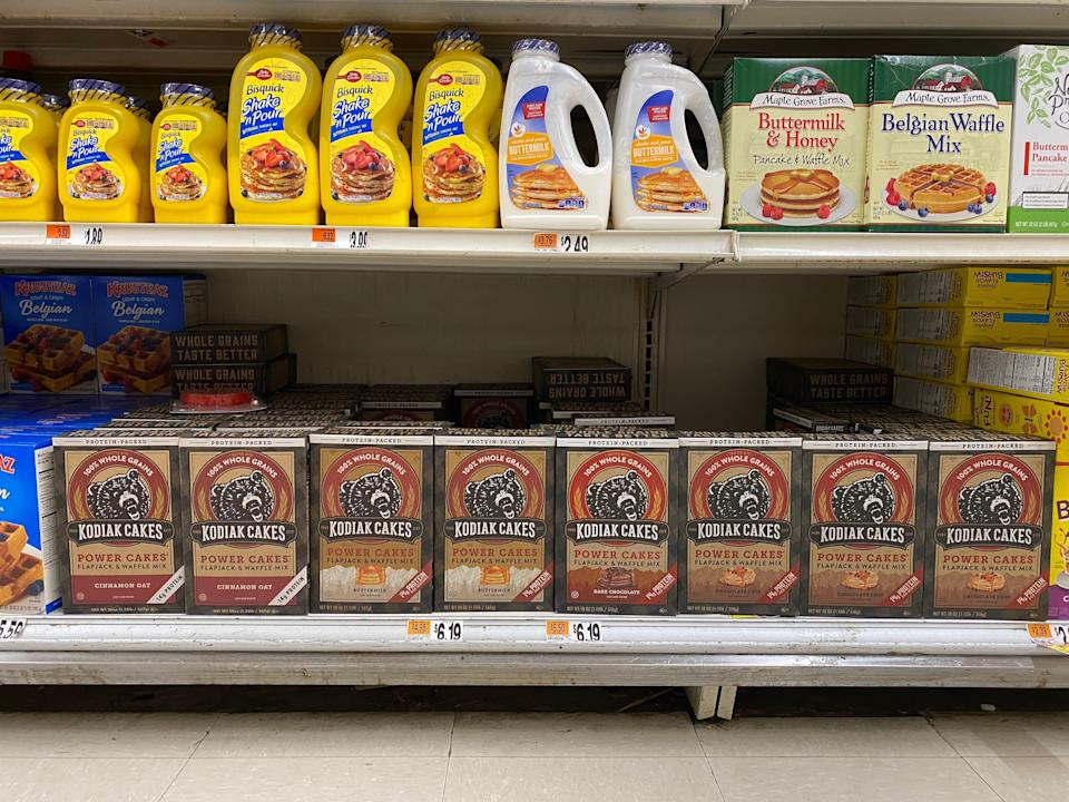two shelves at the grocery store filled with pancake mix