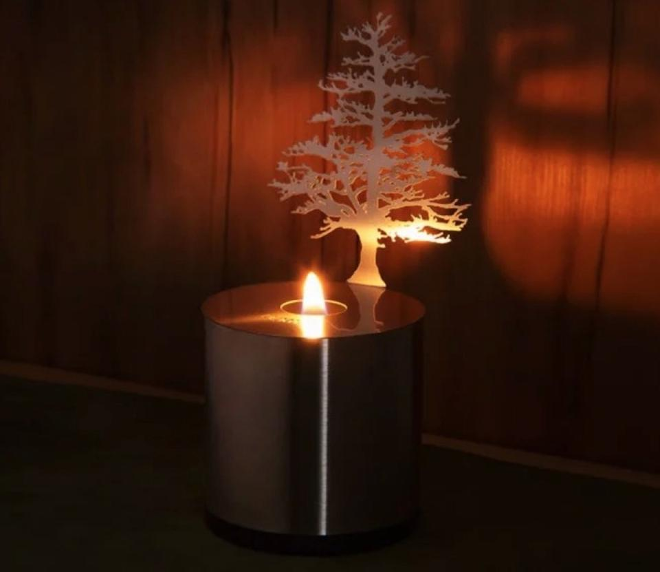 tea light in metal can with cutout tree, fall decorating tips